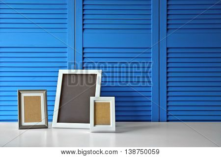 Photo frames on blue folding screen background