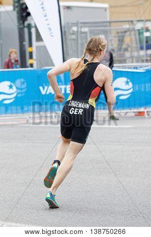 STOCKHOLM - JUL 02 2016: Triathlete Laura Lindemann (GER) running in a curve rear view in the Women's ITU World Triathlon series event July 02 2016 in Stockholm Sweden