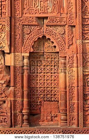 Intricate detail carved in red sandstone at the Qutub Minar complex, Delhi, India