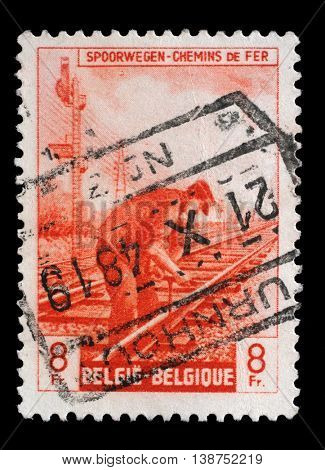 ZAGREB, CROATIA - JULY 03: A stamp printed in Belgium shows Railway Worker from The Railway Company at Work issue, circa 1945, on July 03, 2014, Zagreb, Croatia