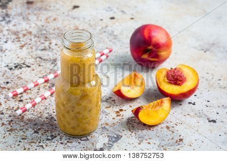 Healthy summer smoothie with nectarine orange juice chia seeds honey. Concrete background horizontal