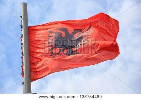 Flag of Albania against the blue sky