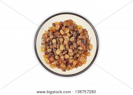 Raisins in a clear glass dish top view close up isolated