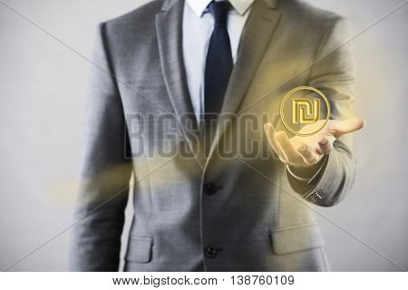 Man pressing buttons with israeli shekel