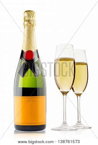 Champagne bottle and champagne glass on white