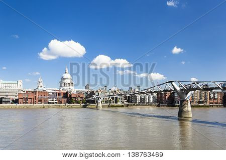 Millennium Bridge in London with St. Paul's Cathedral in the background and a beautiful sky