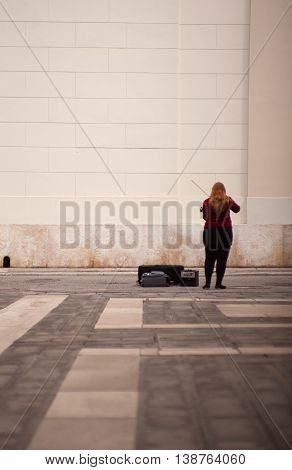 TRIESTE ITALY - MAY 14: Female violinist playing in the street on May 14 2016