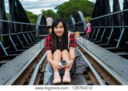 Asian Women Traveler Photography With Camera On Rail Way