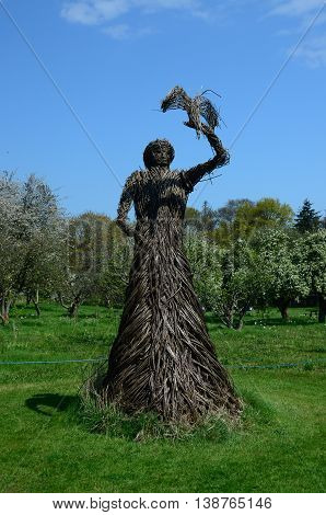 A wicker woman statue in the gardens of Falkland palace