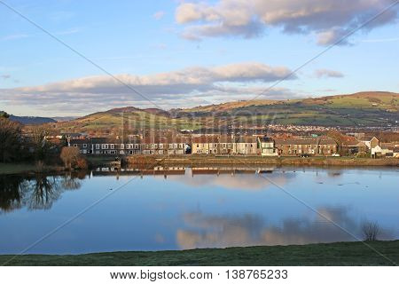 Town of Caerphilly by a lake in Wales