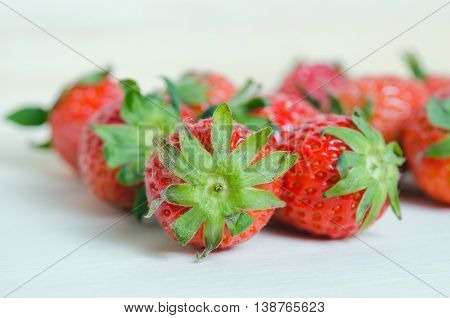 Strawberry fruits with flash filled on wooden board (Other names are Fragaria strawberry Fragaria ananassa)