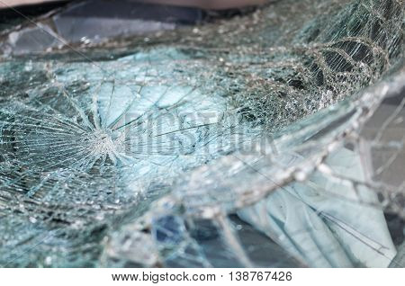 Automobile window warped into web of cracks from crash