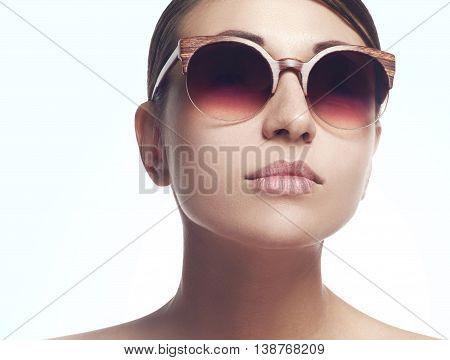 Young Female Fashion Model Wearing Big Sunglasses On White Background