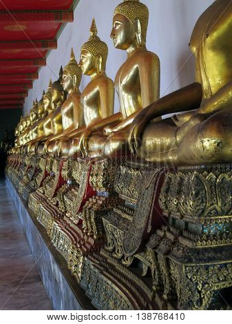 Ancient buddhist statues in Wat Po in Bangkok