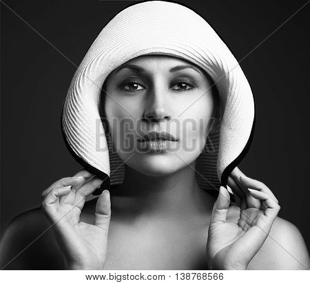 Beauty Woman Face Portrait In A White Hat. Beautiful Model Girl With Perfect Fresh Clean Skin. Femal