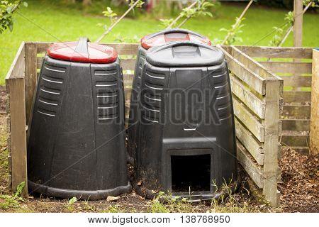 Image of compost bins in a summer garden