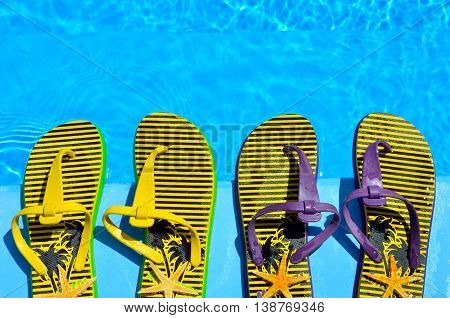 Flip-flops and starfish in the pool background.
