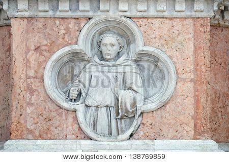 BOLOGNA, ITALY - JUNE 04: Saint Francis by Paolo di Bonaiuto relief on facade of the San Petronio Basilica in Bologna, Italy, on June 04, 2015