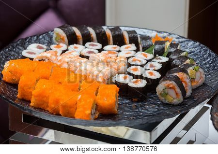 Many Kind Of Sushi Roll In Black Plate
