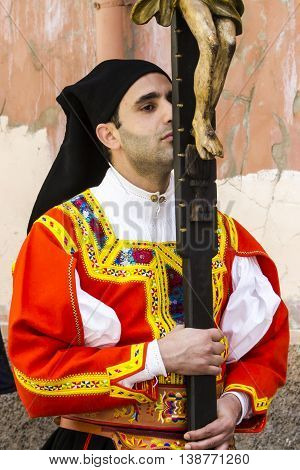 AGLIARI, ITALY - May 1, 2016: 360 ^ Sant'Efisio Festival - Sardinia - portrait of a man with the crucifix in traditional Sardinian costume