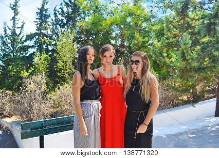 greek girls formally dressed at an Orthodox christening
