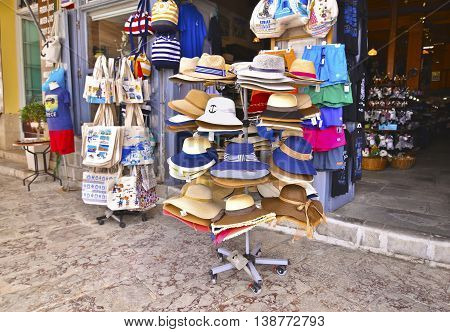 HYDRA ISLAND GREECE, MAY 27 2016: touristic shops with souvenirs, hats and clothes at Hydra island Greece. Editorial use.
