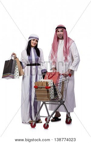 Happy arabic family after shopping isolated on white