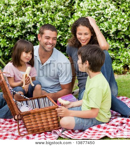 Family picnicking in the garden