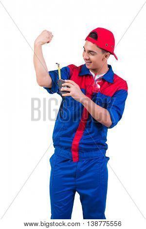 Young repairman measuring his biceps isolated on white