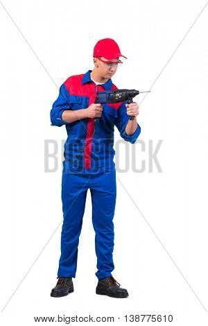 Young repairman with drill perforator isolated on white