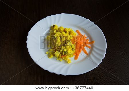 Millet risotto with curry with tofu on plate