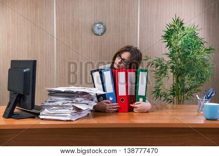 Businesswoman under stress working in the office