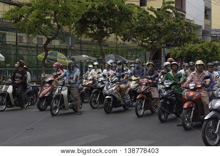 Saigon (Ho Chi Minh City) Viet Nam March 19 2016 Saigon's streets are crammed with people on motorbikes the dominant mode of transportation.