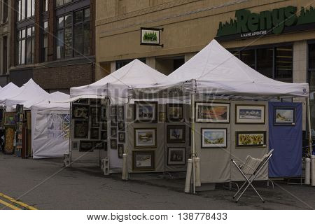 Portland Maine USA August 21 2015 Annual juried art show where artists set up tents and display thier art for sale