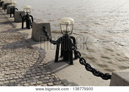 Columns with the chains at the embankment of Moskov River. Russia
