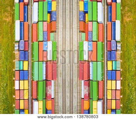Aerial view of containers at railway near wheat field. Industrial background. Industry from above. Environment and transportation.