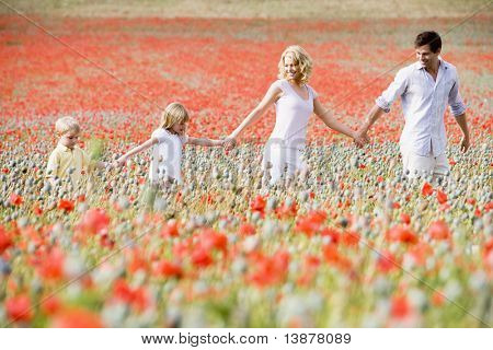 Family walking through poppy field
