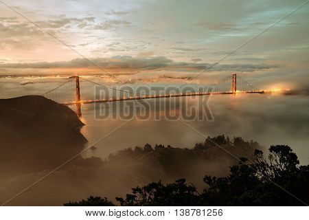 Golden Gate Bridge and fog in San Francisco in early morning