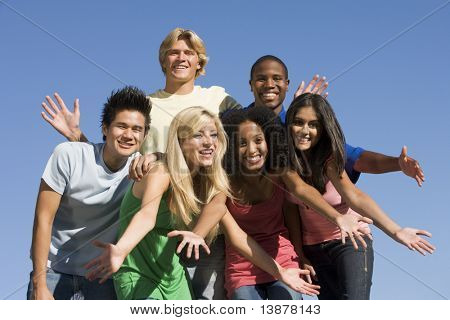 Group of six friends having fun outside
