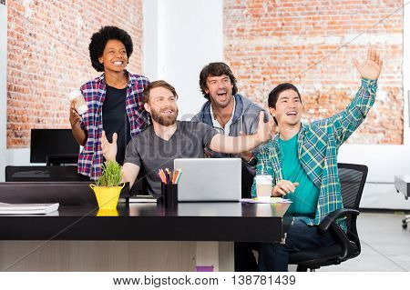 Excited people office diverse mix race group businesspeople surprised happy smile laptop computer casual wear
