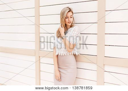 Beautiful Stylish Girl In Vintage Lace Blouse With Ornament Posing Near The Wooden Wall