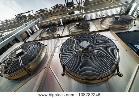 Cooling industrial air conditioning units closeup. Fans closeup.