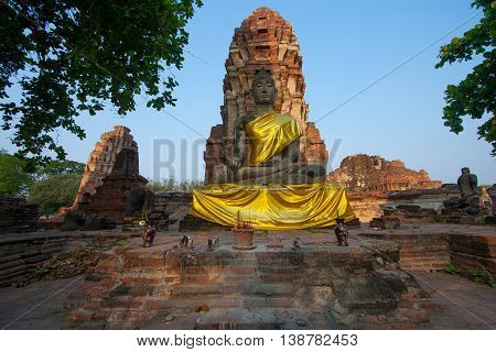 Stone Buddha in front of pagodathe at Corridor of Mahathat temple ( Thailand is called Wat Mahathat ) in Ayutthaya Thailand.