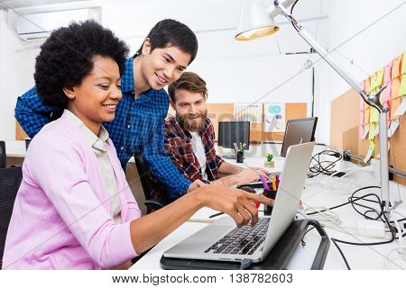 People office diverse mix race group businesspeople working woman point finger laptop casual wear
