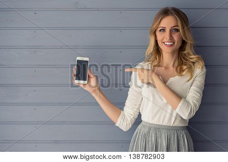 Beautiful Young Woman With Gadget
