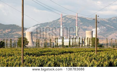 picture of a power plant with corn field