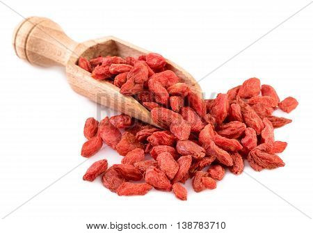 Wooden spoon with dried goji berry. Goji berries isolated on white.