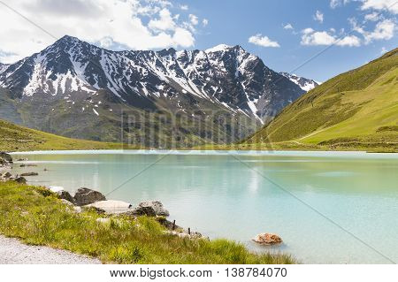 Rifflsee In Austria With Snow Covered Mountains