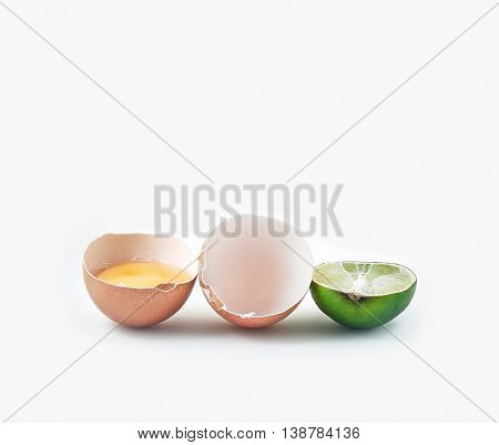 Brown Egg And Lime On White Background