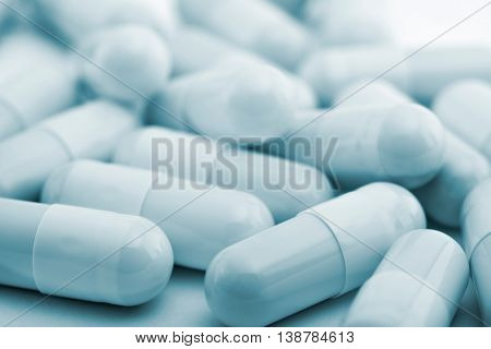 Medicine Bottle Pills Blue Background. White Plastic Bottle, Cardboard Packaging. Medicine And Vitam